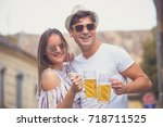 young hipster couple in love... | Shutterstock . vector #718711525