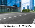 empty road and modern office... | Shutterstock . vector #718714354