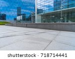 empty pavement and modern... | Shutterstock . vector #718714441