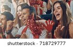 group of fans cheer for their... | Shutterstock . vector #718729777