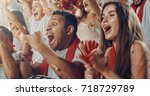 group of fans cheer for their... | Shutterstock . vector #718729789