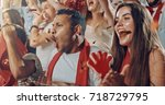 group of fans cheer for their... | Shutterstock . vector #718729795