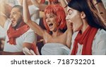 group of fans cheer for their... | Shutterstock . vector #718732201