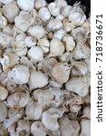 Small photo of Garlic, white garlic background