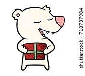 cartoon polar bear with present   Shutterstock .eps vector #718737904