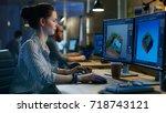 female game developer works on...   Shutterstock . vector #718743121