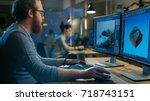 creative male game developer... | Shutterstock . vector #718743151