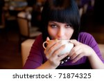 girl hold cup of coffee in hand look straight - stock photo