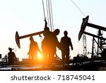 the oil workers at work | Shutterstock . vector #718745041