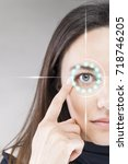 woman pointing to eye | Shutterstock . vector #718746205