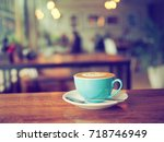 cup of coffee latte in coffee... | Shutterstock . vector #718746949