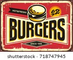 burgers vintage tin sign with... | Shutterstock .eps vector #718747945