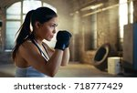beautiful athletic woman holds... | Shutterstock . vector #718777429