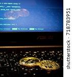 two golden bitcoin coins... | Shutterstock . vector #718783951