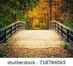 wooden bridge in the autumn...   Shutterstock . vector #718784065