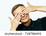 man closes eyes with her hands | Shutterstock . vector #718786441