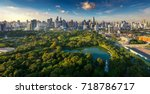 lumpini park and bangkok city... | Shutterstock . vector #718786717