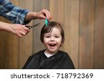 a little boy is trimmed in the... | Shutterstock . vector #718792369