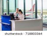 ground staff using computer at... | Shutterstock . vector #718803364