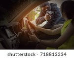 Small photo of Bandit man with masked robber holding handgun weapon gangster to hijack hostage woman driver car shocked and dangerous on street violence concept