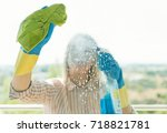 house cleaning. woman is wiping ...   Shutterstock . vector #718821781