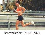 female runner jogging on the... | Shutterstock . vector #718822321