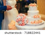 peach color big wedding cake...   Shutterstock . vector #718822441