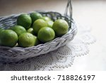 close up lime in a white basket   Shutterstock . vector #718826197