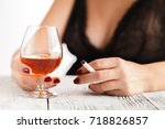 woman in lingerie sitting at a... | Shutterstock . vector #718826857