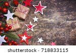 rustic christmas background... | Shutterstock . vector #718833115