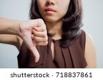 thumb down woman . feeling sad  | Shutterstock . vector #718837861