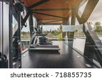 small gym in luxury villa  big... | Shutterstock . vector #718855735
