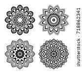 round flower mandala ornament.... | Shutterstock .eps vector #718862341