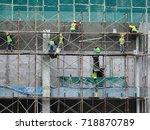 construction workers wearing... | Shutterstock . vector #718870789