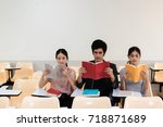 group of three students reading ...   Shutterstock . vector #718871689