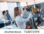 picture of designers sticking... | Shutterstock . vector #718872595