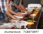 hands of people making pizzas... | Shutterstock . vector #718873897