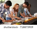 group of vietnamese young... | Shutterstock . vector #718873909