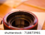 Small photo of A close up look of a lens adapter with autofocus contacts