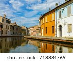 building reflections on canal... | Shutterstock . vector #718884769