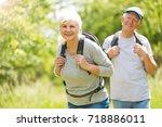 senior couple hiking  | Shutterstock . vector #718886011