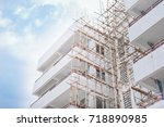 high building on blue sky... | Shutterstock . vector #718890985