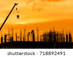silhouette crane  workers and... | Shutterstock . vector #718892491