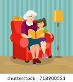 grandmother is reading a book... | Shutterstock .eps vector #718900531