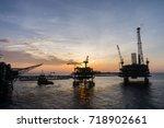 silhouette of bridge connected... | Shutterstock . vector #718902661