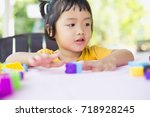 little girl playing with... | Shutterstock . vector #718928245