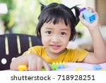 little girl playing with... | Shutterstock . vector #718928251