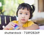 little girl playing with... | Shutterstock . vector #718928269