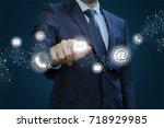 businessman clicks on the...   Shutterstock . vector #718929985