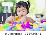 little girl playing with... | Shutterstock . vector #718934641
